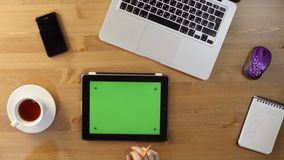 Using  Tablet PC with a Green Screen at the Desktop. Top View stock video footage