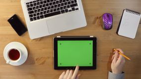 Using  Tablet PC with a Green Screen at the Desktop. Top View stock footage