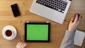 Using  Tablet PC with a Green Screen at the Desktop. Top View stock video