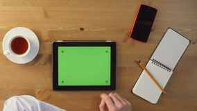 Using Tablet PC with a Green Screen. stock footage