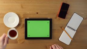 Using Tablet PC with a Green Screen. Top View.With Various Hand Gestures stock footage