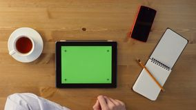 Using Tablet PC with a Green Screen. stock video