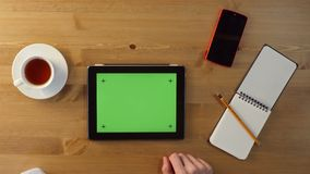 Using Tablet PC with a Green Screen. stock video footage