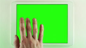 Using Tablet Pc With Green Screen. Using tablet Pc with various hand gestures (scrolling, touching,typing stock video footage