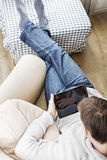 Using tablet pc at home Stock Image