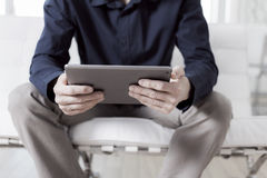 Using tablet pc at the office Stock Photos