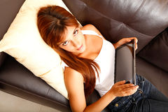 Using a Tablet PC on the Sofa Stock Photos