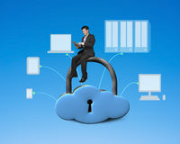 Using tablet and sitting on cloud shape locker Stock Photos
