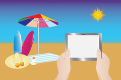 Using tablet at summer beach Royalty Free Stock Images