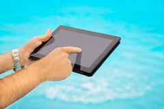 Using tablet on vacation Royalty Free Stock Photos