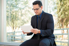 Using a tablet at work Royalty Free Stock Photography