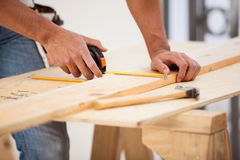 Using a tape measure royalty free stock image