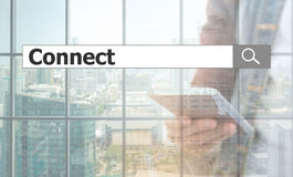 Using text search. connect. Connect concept, using text search. connect against the background of the phone in the city stock photography