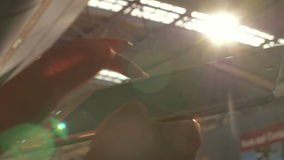 Using touch pad at the station against bright. Slow motion and close-up shot of female hands using tablet PC at the station. Bright sun flare and metal roof stock footage