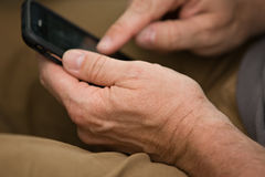 Using touch phone. Man hands using touch phone electronics Royalty Free Stock Image