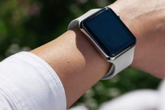 Using Touch Screen Smart Watch Outdoor Royalty Free Stock Image