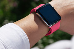 Using Touch Screen Smart Watch Outdoor Royalty Free Stock Photos