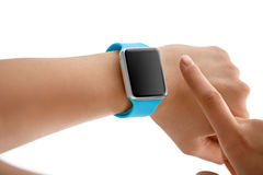 Using Touch Screen Smart Watch. Women Using Touch Screen Smart Watch with Blue Strap Stock Image