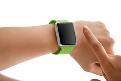 Using Touch Screen Smart Watch. Women Using Touch Screen Smart Watch with Blue Strap on White Background Royalty Free Stock Image