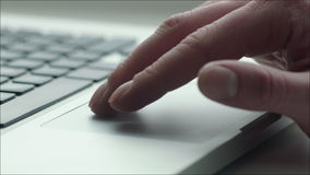 Using Touchpad of Laptop. Closeup shot of a laptop touchpad, someone is using it, moving cursor and zooming the image stock footage