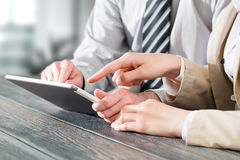 Using touchpad at meeting. Business concepts. Royalty Free Stock Photography