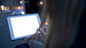 Using touchpad outdoor in the evening Royalty Free Stock Photo