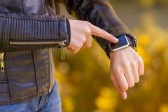 Using touchscreen smart watch Stock Photography