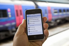 Using a UK Train Timetable App Stock Images