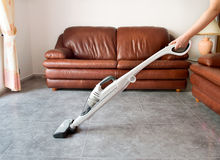 Using the  vacuum cleaner Stock Image
