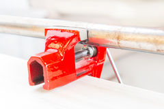Using a vise to hold a rusty pipe Stock Photo