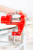 Using a vise to hold a rusty pipe Royalty Free Stock Photography