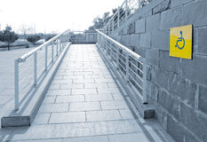 Using wheelchair ramp Royalty Free Stock Images