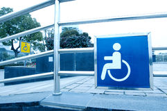 Using wheelchair ramp Stock Images