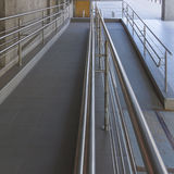 Using wheelchair ramp. (Barrier-free access Stock Photo