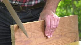 Using a wood rasp on the edge of a board. Woodworking rasp creates a bevel on the board angle stock footage