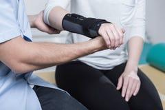 Using wrist immobiliser Royalty Free Stock Image