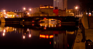 Usingers on the Milwaukee River. Reflection of the historic Usingers Sausage Factory on the Milwaukee River, in downtown Milwaukee, Wisconsin Royalty Free Stock Images