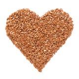 Usitatissimum ou lin oléagineux organique de Linum de graine de lin dans la forme de coeur photo stock