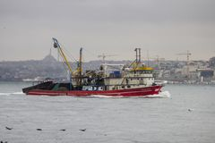 Uskudar, Istanbul / Turkey - 2019 February 6th: A commercial fishing boat is passing the Bosphorus to North. royalty free stock images