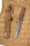 USMC OKC3s bayonet. USMC OCK3S bayonet and desert camouflage American USMC marine corps military inteceptor OTV body armour as used in Afghanistan and Iraq royalty free stock images