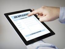 Uso de trabajo en una tableta Fotos de archivo libres de regalías