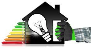 Uso eficaz da energia - House modelo e ampola Foto de Stock Royalty Free