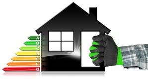 Uso eficaz da energia - símbolo na forma da casa Fotografia de Stock Royalty Free