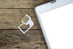 Uso esperto do telefone com o micro cartão do sim pelo adaptador e pelo cartão normal do sim Foto de Stock Royalty Free