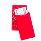 Uso rojo chino del sobre en festival chino del Año Nuevo en blanco Imagen de archivo libre de regalías