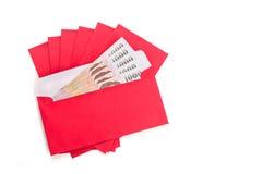 Uso rojo del sobre en festival chino del Año Nuevo en blanco Fotografía de archivo libre de regalías