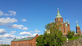 Uspenski Cathedral in Helsinki, Finland. During the sunny day with cloudy sky. Panning time-lapse stock footage