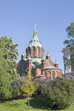 Uspenski cathedral in helsinki with purple and white flowering t Stock Photo