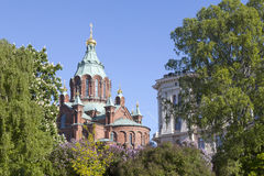 Uspenski cathedral in helsinki with purple and white flowering t Stock Images