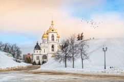 Uspensky Cathedral in Dmitrov. Uspensky Cathedral in the Kremlin in Dmitrov on a winter frosty day and snowy hills Stock Photography